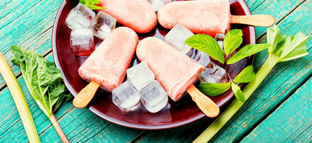 Vegan ice cream on stick with rhubarb and mint
