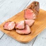 Sliced roast beef on the wooden board